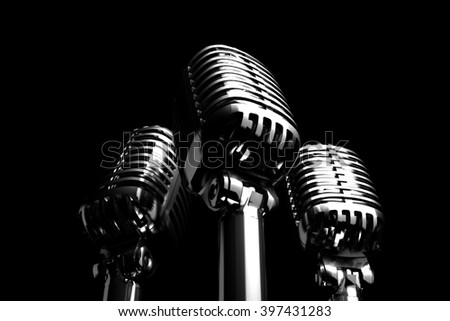 Three Silver retro microphones symbolizing trio, backing vocalist or a trio of singers. 3D illustration - stock photo