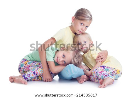 Three sisters embracing on white background - stock photo