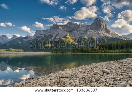 Three Sisters Mountain Range as seen from Spray Lakes, Canmore Alberta - stock photo