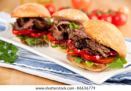Three Small Ciabatta Sandwiches with Grilled Bell Peppers, Tomatoes, Arugula and Pulled Beef - stock photo