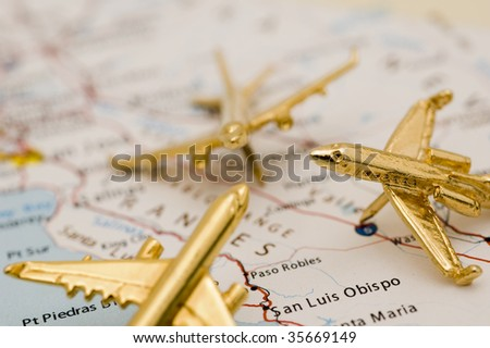 Three Small Golden Planes Over California. Map is Copyright and Trademark Free, Downloaded off www.nationalatlas.gov - stock photo