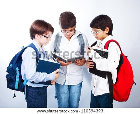 Three smart boys read books, classmates make homework, schoolboys learning lesson, clever three male pupil in glasses isolated on white background, back to school, studying and education concept - stock photo