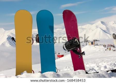 Three snowboards in snow at ski resort Gudauri, Georgia - stock photo