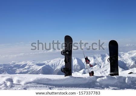 Three snowboards in snow near off-piste slope in sun day. Caucasus Mountains, Georgia, ski resort Gudauri. - stock photo
