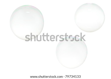 Three soap bubbles isolated on white background - stock photo
