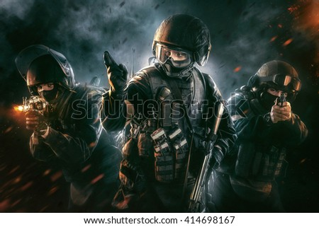 Three soldiers in full uniform with weapons is going to attack. Uniform conforms to special services FSB (soldiers) of the Russian Federation. Shot in studio. Explosion on a black background - stock photo