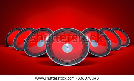 Three speakers are on a red background. - stock photo