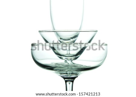 Three stacked glass. Isolated on white background shot in studio lighting. - stock photo