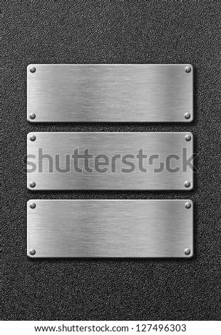 three stainless steel metal plates - stock photo