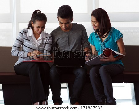 Three students in discussion - stock photo