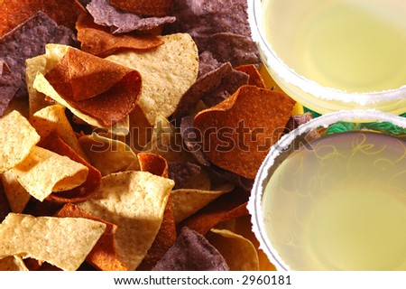 Three styles of Corn Chips and Margaritas  - stock photo