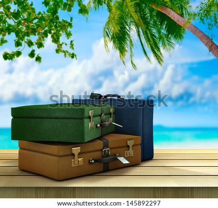 Three suitcases on outside in a paradisical location - stock photo