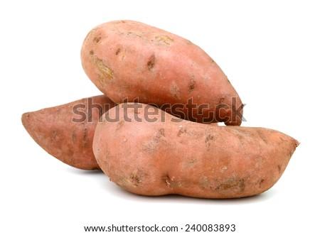 three sweet potatoes isolated on white background  - stock photo