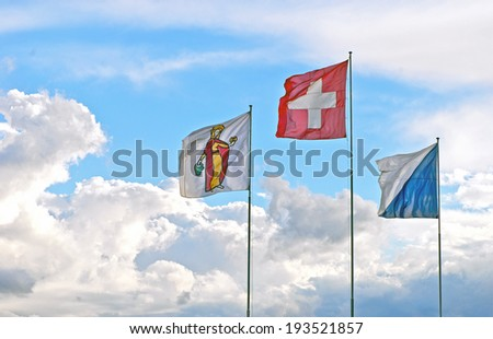 Three Swiss Flags: National Flag (Center), Flag of Zurich,(right) and Flag of the Patron Saint Verena (left) from the region of Thebes who joined the Legion on its mission to Switzerland. - stock photo