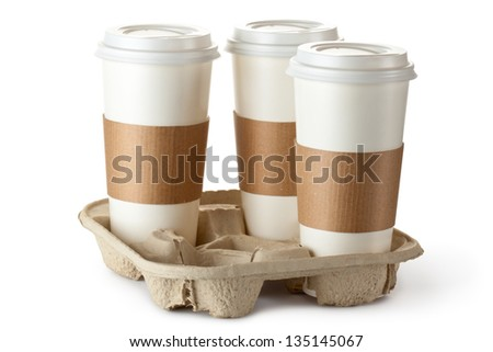 Three take-out coffee in holder. Isolated on a white. - stock photo