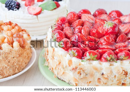Three tasty cakes with fresh berries - stock photo