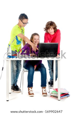 Three teenagers are helping each other with there homework - stock photo