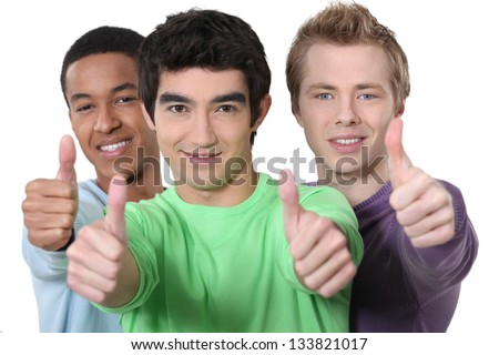 Three teenagers giving the thumbs up - stock photo
