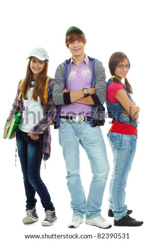 Three teenagers in casual clothes posing in front of camera - stock photo