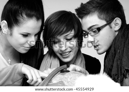 three teens choosing places for travel - stock photo