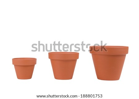 Three terracotta planters of different sizes on white. - stock photo