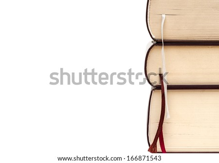 Three thick books isolated on white background - stock photo