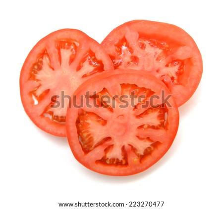 Three tomato slices over a white background  - stock photo