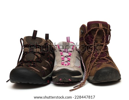 three trekking shoes for the family: father, mother and child  - stock photo