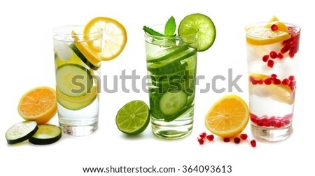 Three types of detox water with fruit in glasses isolated on a white background - stock photo