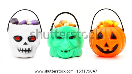 Three types of Halloween candy holders filled with candy corn - stock photo