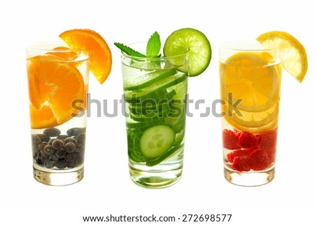 Three types of nutritious detox water with fruit in glasses isolated on a white background - stock photo