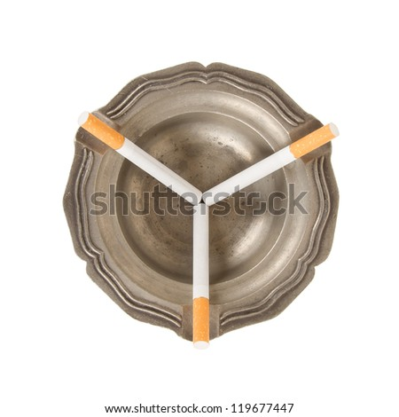 Three unused cigarettes in a old tin ashtray - stock photo