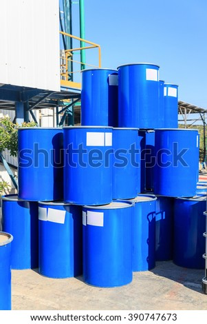 Three vertical rows of blue barrels - stock photo