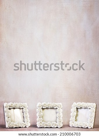 Three vintage frames against a textured background. Empty, ready for photos to be added. Vertical orientation with plenty of copy space. - stock photo