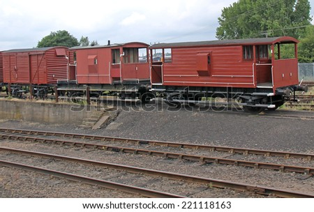 Three Vintage Goods Wagons in a Railway Siding. - stock photo