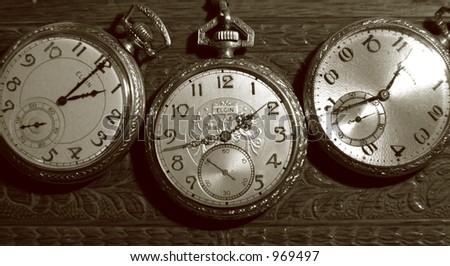 Three Vintage Pocket Watches - stock photo