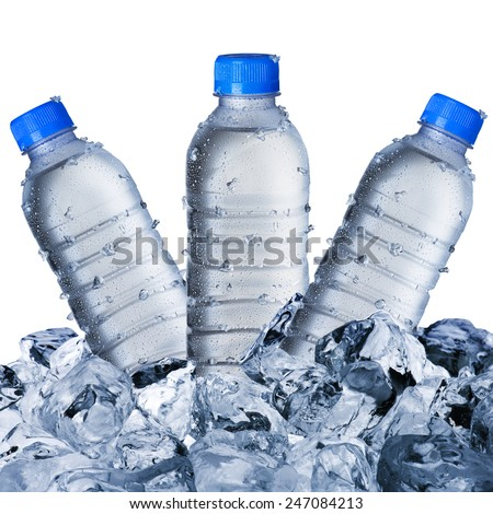 Three Water Bottles on Ice Cubes - stock photo