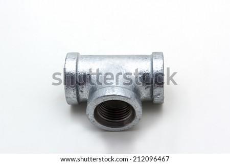Three way plumbing pipes on white background - stock photo