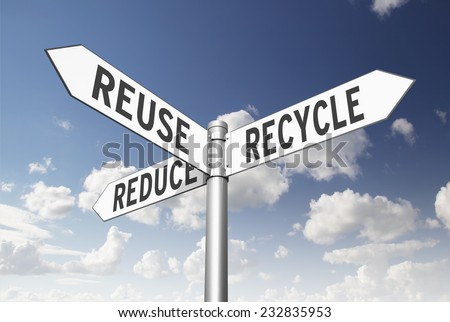 Three way signpost pointing to reduce, reuse, and recycle. - stock photo
