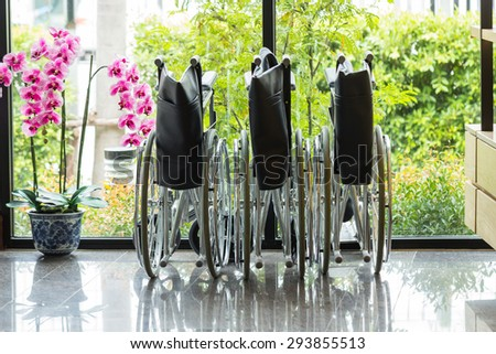 Three Wheelchair is prepared for service - stock photo