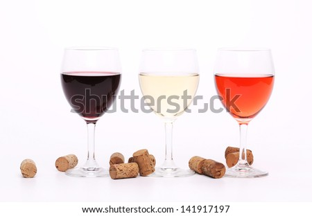 Three wine glasses and corks on the background. - stock photo