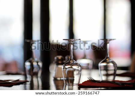 Three wine glasses on a table - stock photo