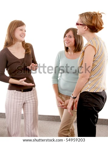 Three woman standing together talking and laughing - stock photo