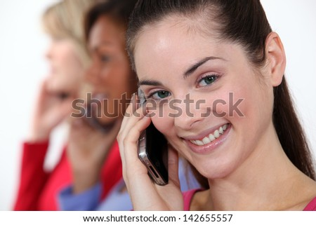 Three woman using their mobiles - stock photo