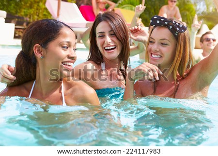 Three Women Having Fun In Swimming Pool - stock photo