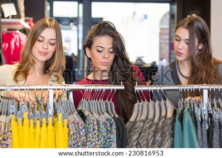 Three Women in a Clothing Store - stock photo