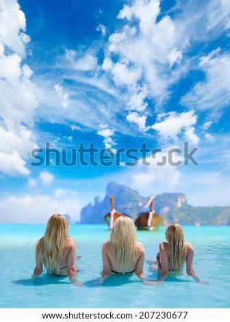 Three Women in beautiful lagoon at Phi Phi Ley island - stock photo