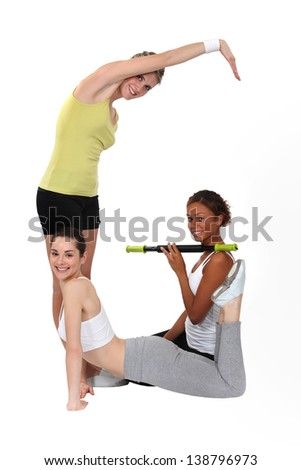 Three women shaping the G letter on white background - stock photo