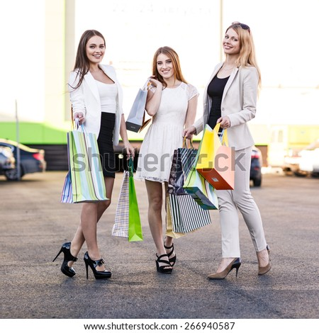 Three women were shopping in a mall or shopping centre and driving home now with their car - stock photo