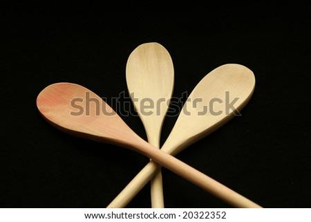 Three wooden spoons crossed - stock photo